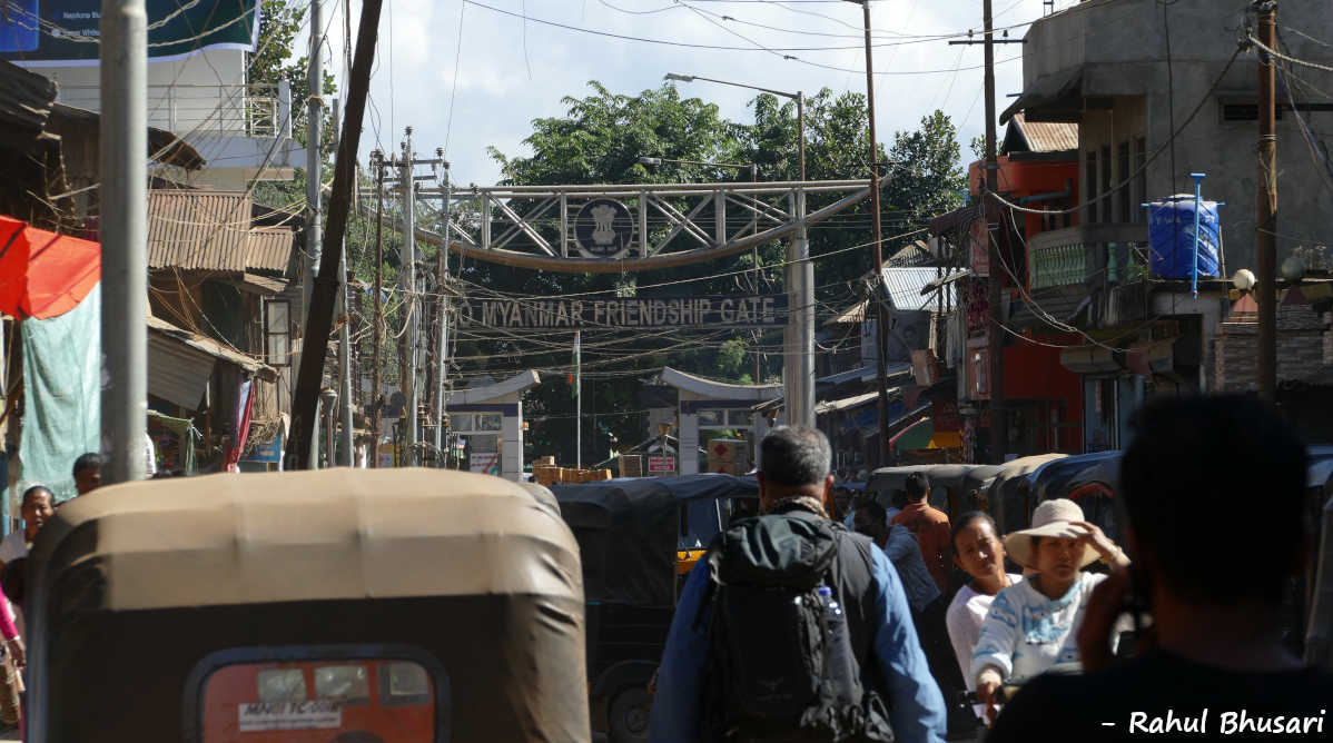 The image shows the chaotic bazaar on Indo-Myanmar border at Manipur, India.